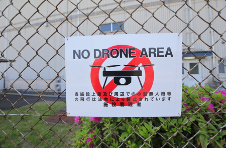No Drone area sign in Japan. Translation-Use of drone or any small flying object in this area is prohibited by law. 写真素材