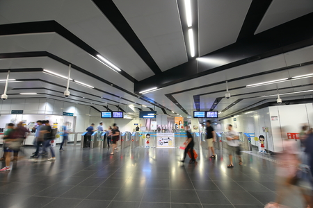 Singapore-November 16, 2018: Unidentified people travel at MRT subway station in Singapore.