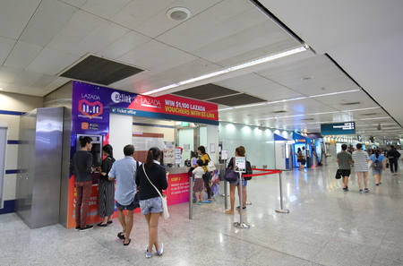 Singapore-November 17, 2018: Unidentified people visit Ez link ticket office at Orchard road station Singapore.Ez link i s public transportation fare payments in Singapore.