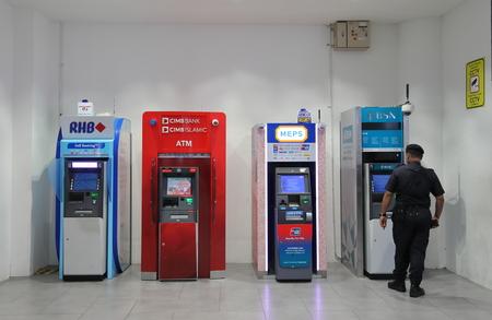 Kuala Lumpur Malaysia - November 23, 2018: Unidentified people use ATM at Kuala Lumpur international airport Malaysia