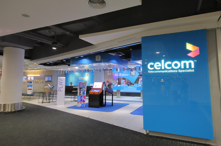 Kuala Lumpur Malaysia-November23, 2018: Unidentified people work at Celcom shop at KLIA airport in Kuala Lumpur Malaysia . Celcom is the oldest mobile telecommunication company in Malaysia.
