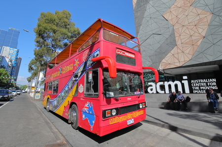 Melbourne Australia - November 26, 2018: Unidentified people take hop on hop off bus in Melbourne Australia