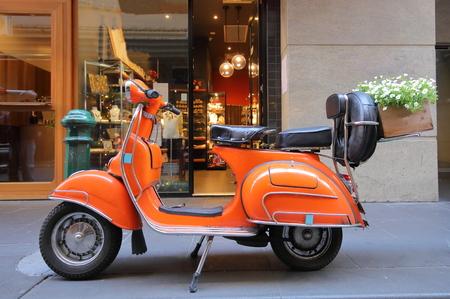Orange scooter motorbike flower basket