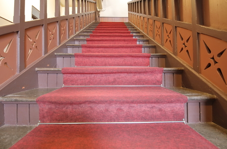 red carpet old wooden stairs