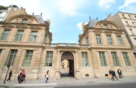 Paris France - May 23, 2019: People visit Hotel de Sully historical building Paris France