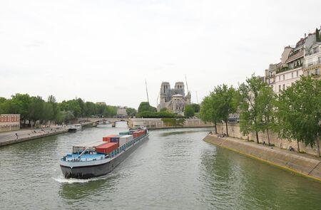 Container tanker Seine river cityscape Paris France 写真素材
