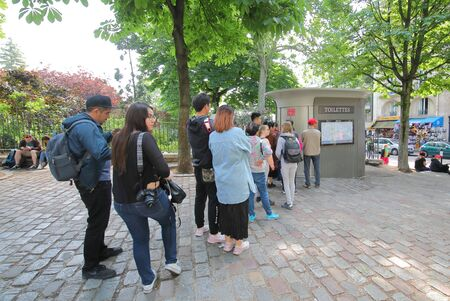 Paris France - May 24, 2019: People queue for public toilet in Paris France