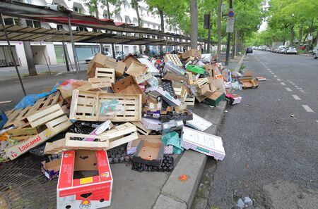 Paris France - May 25, 2019: Rubbish piled up after the weekend street market in Paris France