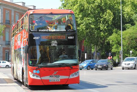 Madrid Spain - May 28, 2019: People travel by Tourist bus Madrid Spain