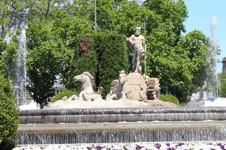 Neptune fountain historical monument Madrid Spain