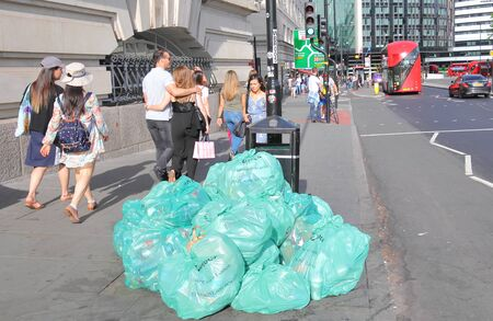 London England - June 2, 2019: Rubbish in Veolia plastic bag piled in downtown London UK