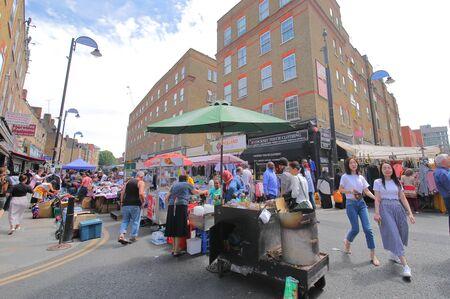 London England - June 2, 2019: People visit Petticoat Lane street market London UK 新聞圖片