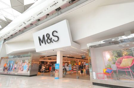 London England - June 4, 2019: People visit Marks and Spencer supermarket Westfield shopping mall London UK Editöryel