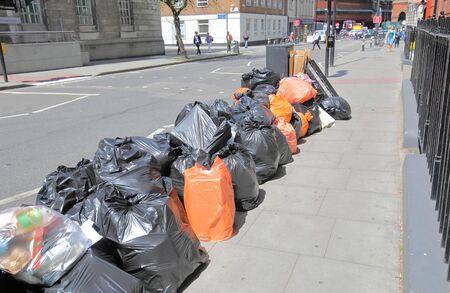 Street rubbish pile London UK