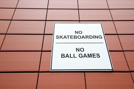 No skateboarding no ball games sign