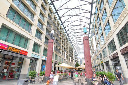 Berlin Germany - June 7, 2019: People visit Berliner Volksbank eG shopping arcade Berlin Germany Editorial