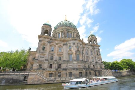 Berlin Germany - June 7, 2019: Spree river boat boat pass Berlin Dome cathedral Berlin Germany