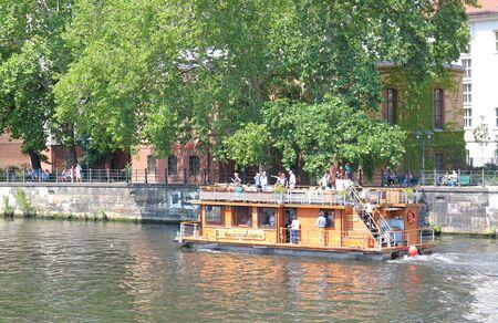 Berlin Germany - June 7, 2019: People take Spree river tour cruise boat Berlin Germany