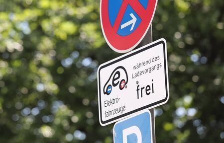 Berlin Germany - June 9, 2019: Electricity charging point for cars sign Berlin Germany 報道画像