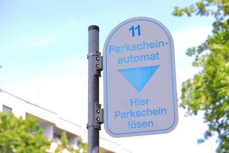 Street car parking ticket machine sign Berlin Germany Banque d'images