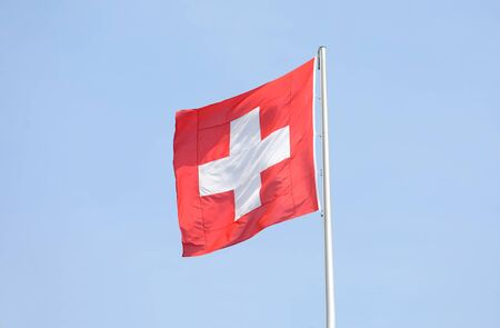 Switzerland Swiss national flag in blue sky