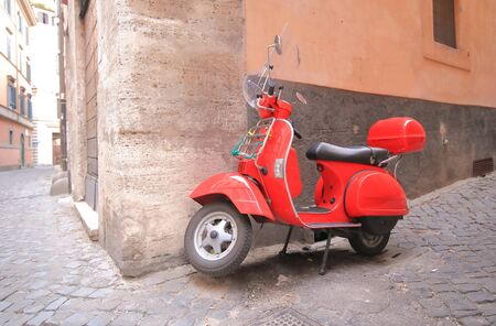 Rome Italy - June 18, 2019: Red scooter alleyway cityscape Rome 에디토리얼