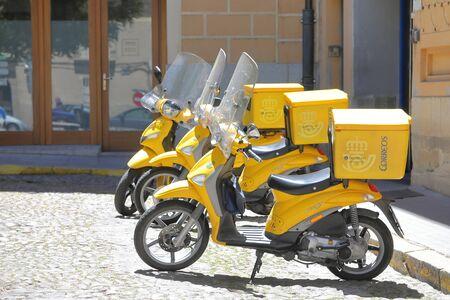 Segovia Spain - May 29, 2019: Spanish post office delivery motorbike parked in Segovia Spain Stock Photo - 131404151