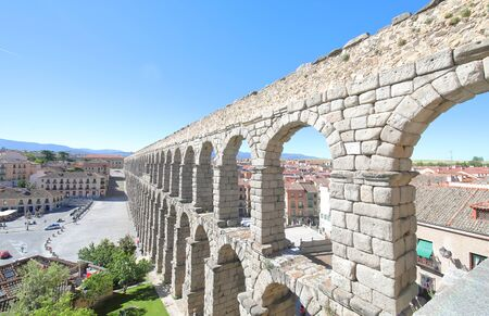 Historical town cityscape and Aqueduct Segovia Spain