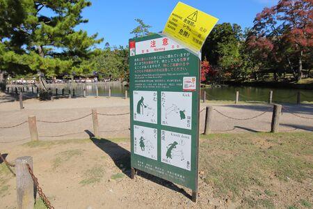 Nara Japan - November 10, 2019: deer warning sign at Nara park Nara Japan