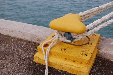A ships cleat holds ship in port