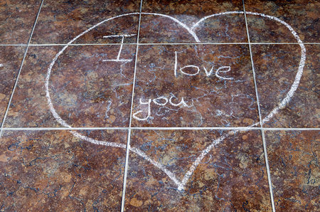 Heart drawn in chalk with the words I love you photo