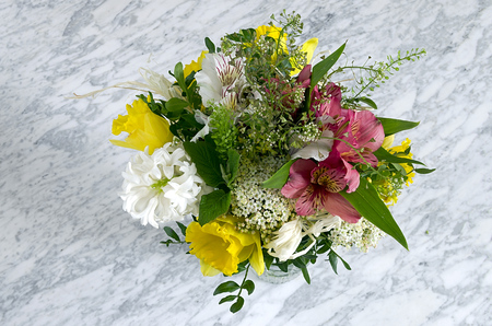 Flowers in a vase on a marble table Stock Photo - 27605677