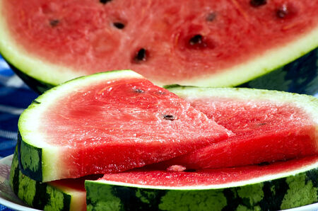 Watermelon sliced into pieces on a plate photo