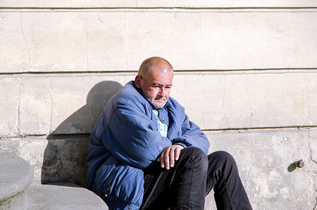 Czech Republic, Prague, October 4, 2014-Homeless man in Pragues Old Town Square in Prague
