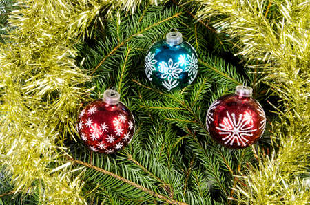 kugel: Three Christmas ornaments with gold chain on spruce branches