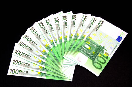 one hundred euro banknote: One hundred euro banknote on a black background Stock Photo