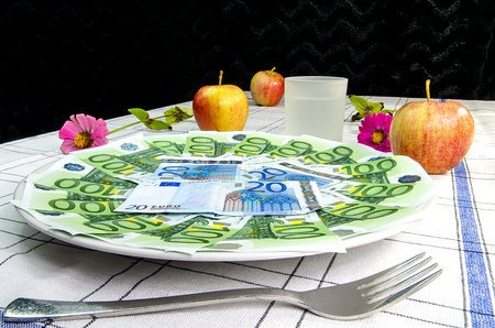 legal tender: Euro banknotes on a plate with cutlery