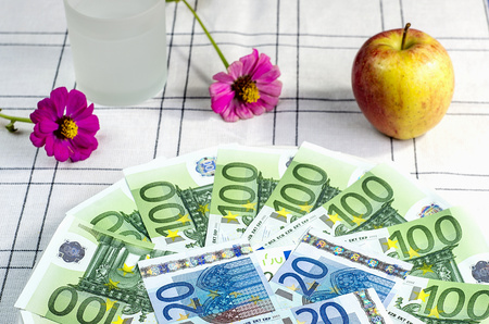 legal tender: Euro banknotes on a plate with apple Stock Photo