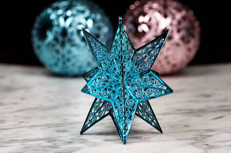 star ornament: Blue Christmas star ornament with two Christmas balls