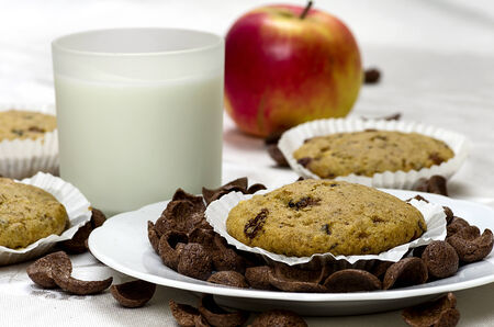Muffins with a glass of milk and apples photo