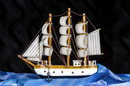 mayflower: Model of white sailboat with three masts on a black background