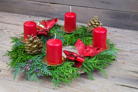 Advent wreath with candles on the wooden table, decorations