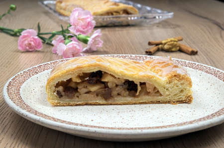 plate of food: Homemade strudel with walnuts and carnations on a plate, food, cinnamon