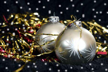 black velvet: Two silver Christmas balls on black velvet, ornament, xmas, snow Stock Photo