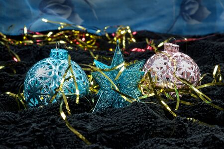 black velvet: Christmas decoration on black velvet with a blue backdrop, Christmas tree decoration