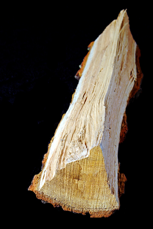wood heating: Detail of oak logs isolated on a black background, forest, wood, heating