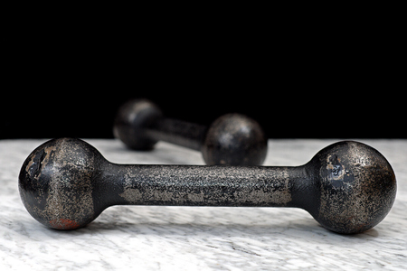 tabel: Two three-kilogram dumbbell on a marble table, exercise muscles, health Stock Photo