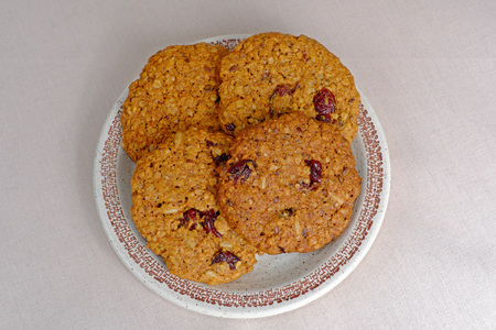 oatmeal cookies: Homemade oatmeal cookies dried cranberries on a plate Stock Photo