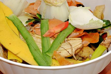 cesium: Vegetable scraps in a white plastic bowl bio waste, carrots, cesium, potato peels, leek