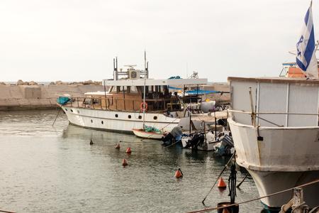 jaffo: TEL AVIV, ISRAEL - May 19 2014: Fishing boats in the port of Jaffa Editorial